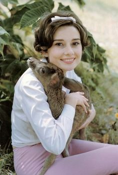 Audrey Hepburn with her fawn