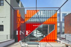On a tree-lined street in Clinton Hill, Brooklyn, a former carriage house from the 1930s is now a colorful modern home that boasts bright orange shipping containers.