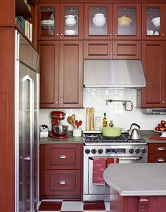 Since we have such a small, galley style kitchen, I would love to add an extra row of cabinets all the way to the high ceiling like in this kitchen!