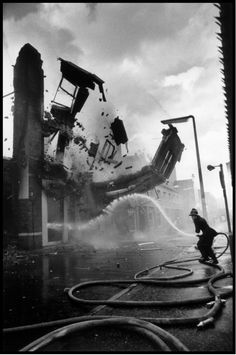 A wall crumbles down after having been set on fire, presumably by the IRA, Belfast. Northern Ireland 1972  Abbas - Magnum Photos