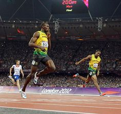 Usain Bolt easily won the 200-meter dash on Thursday, becoming the first man to repeat as 100 and 200 champion in consecutive Olympics. #London2012