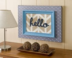 Create unique herringbone DIY canvas art by attaching a painted frame to canvas - so bright and cheery!