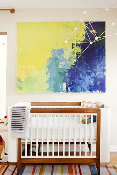 Give your nursery a splash of color with oversized artwork.