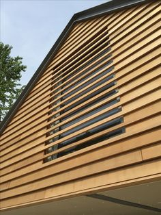 Annabelle Tugby Architects, Cheshire Cedar cladding / louvres and steel portal frame to a contemporary car barn in Cheshire Shed Cladding, Larch Cladding, Exterior Cladding, Garage Studio, Timber Architecture, Architecture Details, Barn Conversion Exterior, Barn Conversions, Steel Building Homes