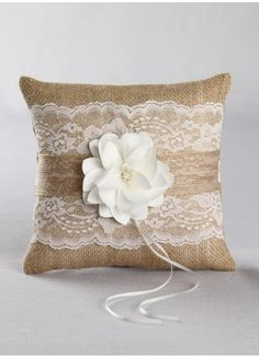 Rustic Garden Collection Ring Pillow. Rustic burlap fabric and delicate lace cover this elegant collection. Layered jute ribbon and a pretty satin flower with a beaded center decorate this collection creating a soft romantic look.
