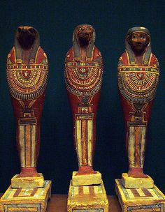 https://flic.kr/p/3GCYux | Ptolemaic mummiform figures representing the sons of Horus | Painted and gessoed wood  Ptolemaic period  ca. 715-30 B.C.   These mummiform statuettes represnt the sons of Horus:  Qebeh-senuf (falcon head), Hapy (baboon head), and Imseti (human head).   Metropolitan Museum of Art  NYC