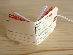 a mini notebook made with printed manilla tag cover.  so cute.