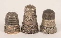 Set of antique thimbles. How beautiful they are. Really, they're tiny pieces of utilitarian art.
