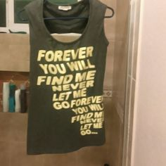 "Forever 21 Blouse Grey worded blouse with little shoulder padding and open back. ""Forever you will find me never let me (covered in clear decoration) Go Forever you will find me never let me go (plain yellow)"" Material does stretch! Forever 21 Tops Blouses"