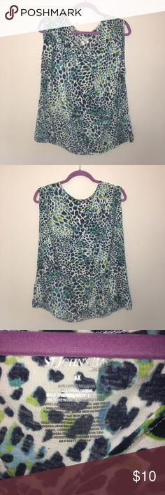 """St. John's Bay Animal Print Tank Top *Used* St. John's Bay multi-color animal print tank top in a plus size 3X. Features shirred design on top of shirt & elastic bottom hem. Colors: white, navy, turquoise, green. Material: 60% Cotton, 40% Modal. Measurements: Length- 26"""", Bust-23"""", Neckline- 12"""". ✨BUNDLE+SAVE✨ St. John's Bay Tops Tank Tops"""