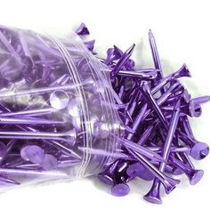 """Includes 12 Purple Metallic Golf Tees. These 2.75"""""""" (70 mm) metallic golf tees are made in the USA from 98%+ recycled material. They are both recyclable and biodegradable. These metallic golf tees are"""