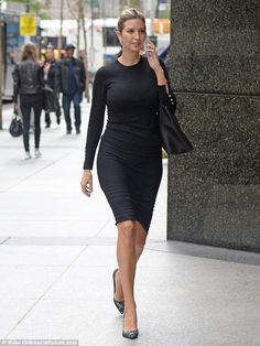 All business: Ivanka Trump walked to her office at Trump Tower on Thursday wearing a figure-hugging ensemble, high heels and some seriously long diamond earrings