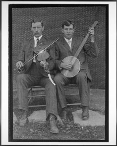 Josh and Henry Reed, ca. 1903. Henry Reed, age 19, plays banjo and his older brother Josh plays fiddle.