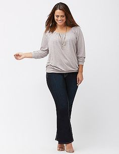 All-over metallic print adds the perfect seasonal shimmer to our slub banded bottom tee. Flattering shirred scoop neck and long sleeves with banded cuffs. lanebryant.com