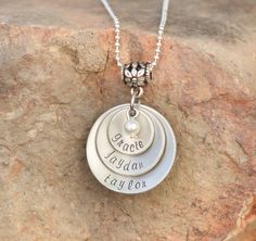 Mothers necklace - Hand stamped with kids names - great for moms, grand as, godmothers or Friends. $23.00, via Etsy.