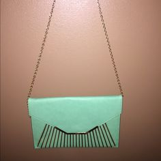 Must have evening bag! Super cute, never used, evening bag! The color is green with gold accents. MMS Bags