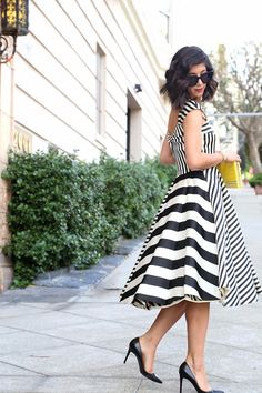 Dress: Katie Ermilio via The RealReal ; Shoes: Christian Louboutin ; Sunglasses: Celine; Clutch: Kate Spade...
