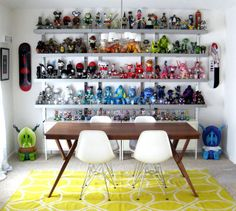 colour graded toy collection on display in dining room of collector sara harvey's house