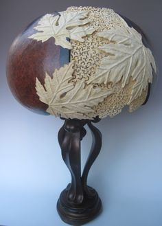 carved gourd lamp      ByJoanna Helphrey  Open lace between leaves and loots sklll