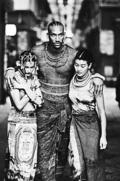 Laetitia Casta, Vladimir McCrary and Jenny Shimizu photographed by Ellen von Unwerth in designs by Jean Paul Gaultier.