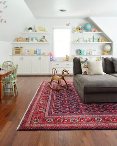 Here's how we designed a fun, functional, family bonus room out of an unfinished storage space above our garage, complete with play areas and a mega couch!