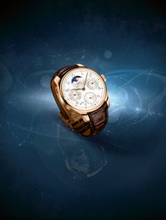 Discover the IWC Portugieser Perpetual Calendar. An attractive combination of a red gold case, silver-plated dial and golden moon against a midnight blue background