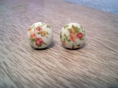 Floral fabric covered button earrings. $3.00, via Etsy.