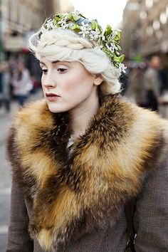 Going for an eccentric Edwardian style, but I just love her pale complexion and the lovely braid with a floral hat. Beautiful!