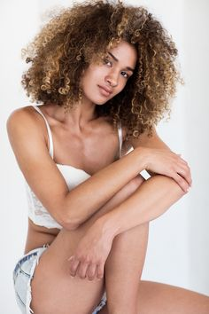 Ksenia Belova Photography Relaxed pose Model jeans  Curly hair Natural light studio