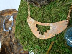 Look at this really awesome Etsy listing at https://www.etsy.com/listing/118630636/all-copper-necklace-small-bib-with-hand