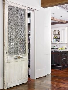 Creatively Convert. love the rustic feel to this sliding door.