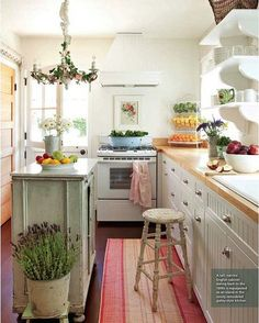 Pretty kitchen with soft mint kitchen island and lavenders in a tin pot