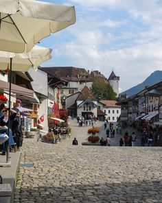 Gruyere, Switzerland - It sits perched on top of a hill among the green, tree-filled mountains, overlooking pastures that are sprinkled with dairy cows.   makingthymeforhealth.com