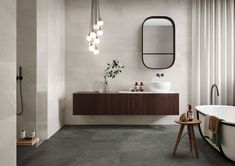 Italgraniti masters the natural essence of slate, creating an intense new porcelain stoneware. Shale banishes artificial solutions, showcasing th. Bathroom Inspo, Bathroom Inspiration, Bathroom Ideas, Concrete Look Tile, Large Format Tile, Wall Hung Vanity, Bathroom Renos, Bathrooms, Bathroom Toilets