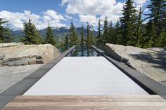 This amazing pool was built by Alka Pool Construction from Vancouver BC. The pool is located in Whistler BC, and winner of many international awards. The HydraLux automatic swimming pool cover is finished with our gray pool cover slats
