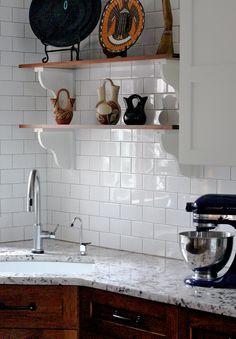 I like the combo of white subway tile backsplash, wood cabinets and marble or marble-like counter.
