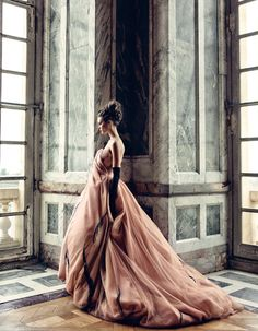 Christian Dior.  This could be me in my swirling dress looking out the window of my castle..*sigh*..I wish.