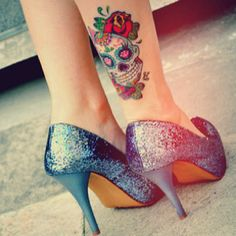 A wonderful sugar skull tattoo paired with gorgeous blue glitter heels. #tattoos #shoes #Day_of_the_Dead