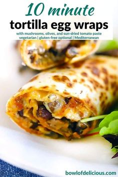 "These Tortilla Egg Wraps inspired by ""Nadiya's Time to Eat"" are packed with Mediterranean flavor from mushrooms, oregano, olives, cheese, and sun dried tomatoes! A 10-minute breakfast, lunch, or dinner recipe that's perfect for one or two people."