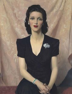 Portrait of Mrs Francine Clore née Halphen, in a black dress, wearing a diamond and emerald bracelet by Sir (Herbert) James Gunn, R.A. (Scottish 1893-1964) signed 'James Gunn' (lower right) oil on canvas 36 x 28 in. (91.5 x 71.1 cm.)