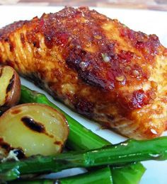 Salmon:  3 tablespoons Thai sweet chili sauce  1 tablespoon soy sauce  1/2 teaspoon sesame oil  2 garlic cloves, minced  1/2 tablespoon ginger, grated  1/4 teaspoon of black pepper  2 salmon fillets  6 small red new potatoes, cut in half  12 stalks of asparagus    Dressing:  2 tablespoons olive oil  1 tablespoon lime juice  zest of 1/2 lime  Salt and pepper to taste