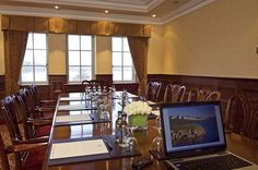 Executive Boardroom: A private meeting room for up to 12 delegates with views over 'Cygnets Rest', the 18th hole of The Faldo Championship Course.