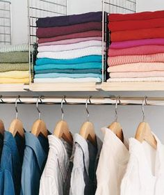 Shelf dividers in a closet keep stack of shirts and sweaters tidy. http://www.retrorealtygroup.com