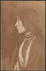 Zitkala Sa, Sioux Indian and activist - Photographed in tribal dress and western clothing, clearly identifying the two worlds in which this woman lived and worked. In many of the images, Zitkala-sa holds her violin or a book, further indicating her interests. Käsebier experimented with backdrops, including a Victorian floral print, and photographic printing. She used the painterly gum-bichromate process for several of these images, adding increased texture and softer tones to the…