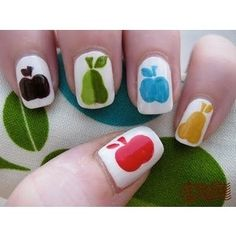 These look like the very hungry caterpillar nails. I love them, and I don't even use nail polish :D
