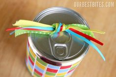 Tin can of treats - Use small can of fruit with pull tab. Use can opener to open from bottom, eat fruit ;) and wash & dry thoroughly.  Place packet of tissue paper filled with candy & treats inside with opening towards top that has pull tab.  Replace can bottom with hot glue and wrap in pretty paper and ribbon.  Gift recipient has a surprise...