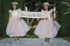 """""""Here Comes the Bride"""" sign carried by flower girls in tulle.Las Vegas Wedding Planner Andrea Eppolito designed this luxury wedding at Red Rock Country Club. By Dzign handled the decor shot by wedding photographer Ella Gagiano."""