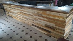 "#Bar, #PalletBar, #PalletWood, #PalletWoodBar, #RecyclingWoodPallets We had a great bar that just didn't look great. We decided to give it a facelift using Pallet Wood! Bar Receives Pallet Wood Facelift: First, we had to break down about 40 pallets. Next, we used 1"" x 2"" strips and attached them to the existing"