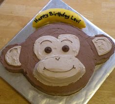 """Monkey Cake - Round cake and two cupcakes.  Trim cupcakes to fit sides of """"head"""".  Mix a small amount of chocolate icing with vanilla to get tan color."""