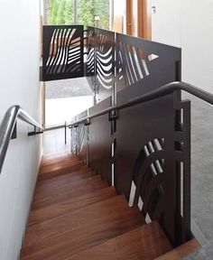 Any pattern could be cut into such panels. Panels could be metal, or nearly any material desired Staircase Handrail, Iron Stair Railing, Metal Stairs, Steel Railing, Metal Railings, Balcony Railing, Modern Staircase, Bannister, Railing Design